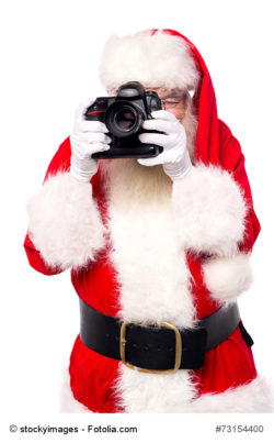 Santa claus taking photos with his new camera